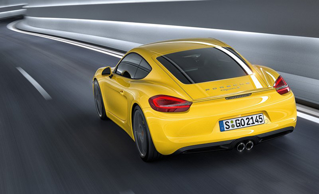 Watch the Porsche Cayman power its way from the city to the countryside...and back