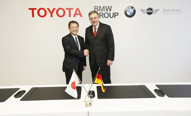 TMC President Akio Toyoda and chairman of the board of management at BMW AG, Norbert Reithofer have signed binding agreements in the collaboration between the two companies