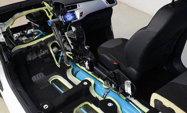 The new hybrid system utilises a compact petrol engine, compressed air and a hydraulic pump