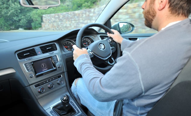 Standard leather-covered multifunction steering wheel and touchscreen add class to the cabin.