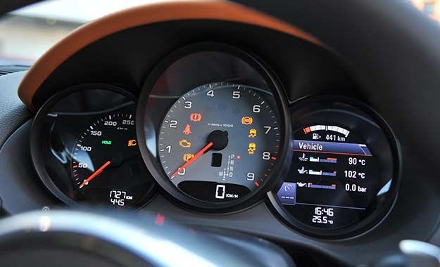 A grey tachometer contains the magical 7 600 r/min red line.