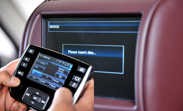 Screens in headrests are controlled by a touchscreen remote control housed in the rear console.
