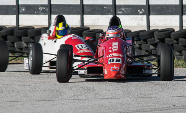 Keegan Campos and Scott Temple challenge for position on track at Scribante.