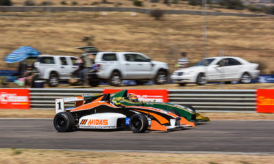 Robert Wolk and Nicholas van Weely race side-by-side at Zwartkops Raceway.