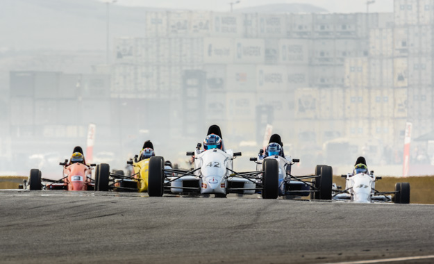 The Formula Ford field heading for turn two at Killarney Raceway.