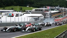 Nico Rosberg manages to get ahead of Lewis Hamilton as the field bunches up toward Turn 1
