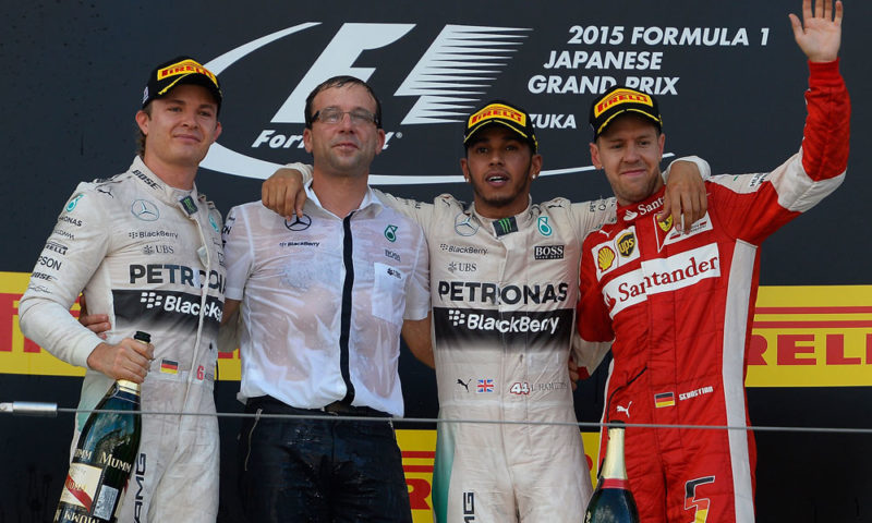 Lewis Hamilton (third from left) beat Mercedes-AMG F1 team-mate Nico Rosberg (left) into the first corner and romped to victory at Suzuka. Sebastian Vettel (right) salvaged third for Ferrari.