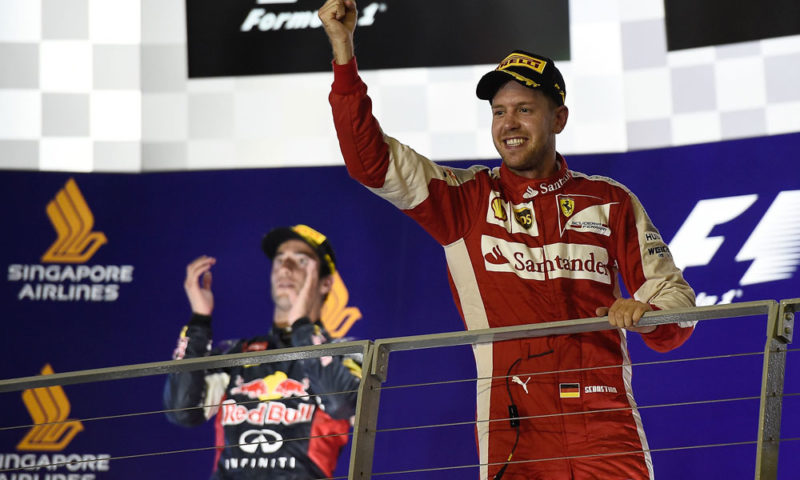 Ferrari's Sebastian Vettel (right) was so dominant in Singapore that second-placed Red Bull's Daniel Ricciardo was never really in contention for the win.
