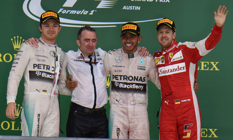 Lewis Hamilton (third from left) had his share of good fortune in a rain-affected US Grand Prix, but an error by Nico Rosberg (left) cost the German the lead late in the race. Sebastian Vettel (right) finished in a strong third for Ferrari.