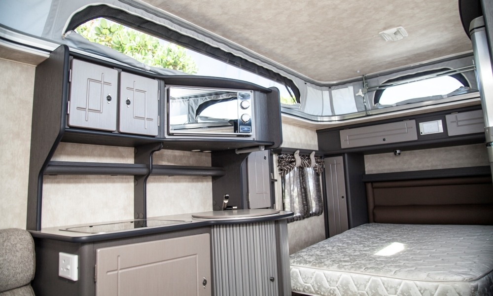 Island double bed and microwave add a touch of sophistication to caravanning.