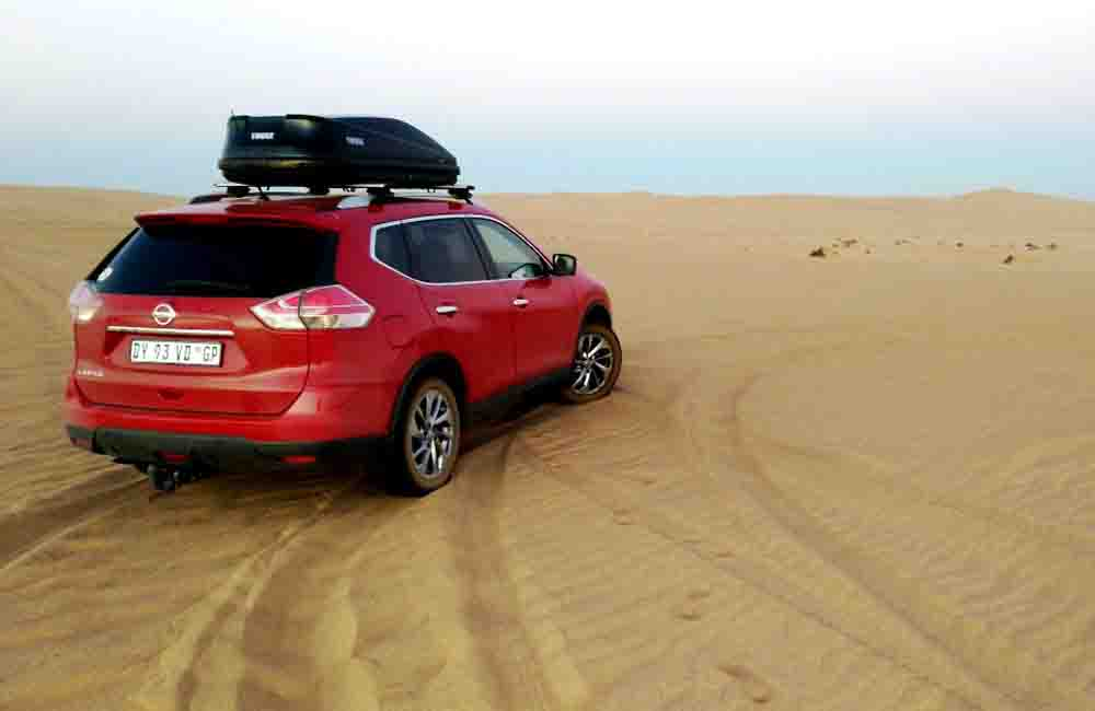 The X-Trail in the dunes before getting stuck.
