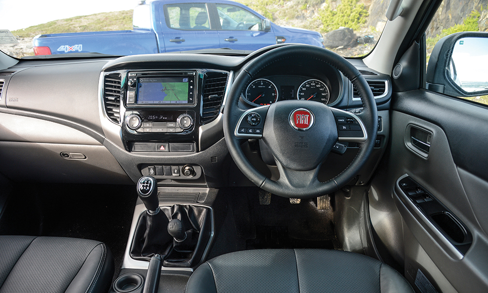 Climate control is standard on the Fiat.