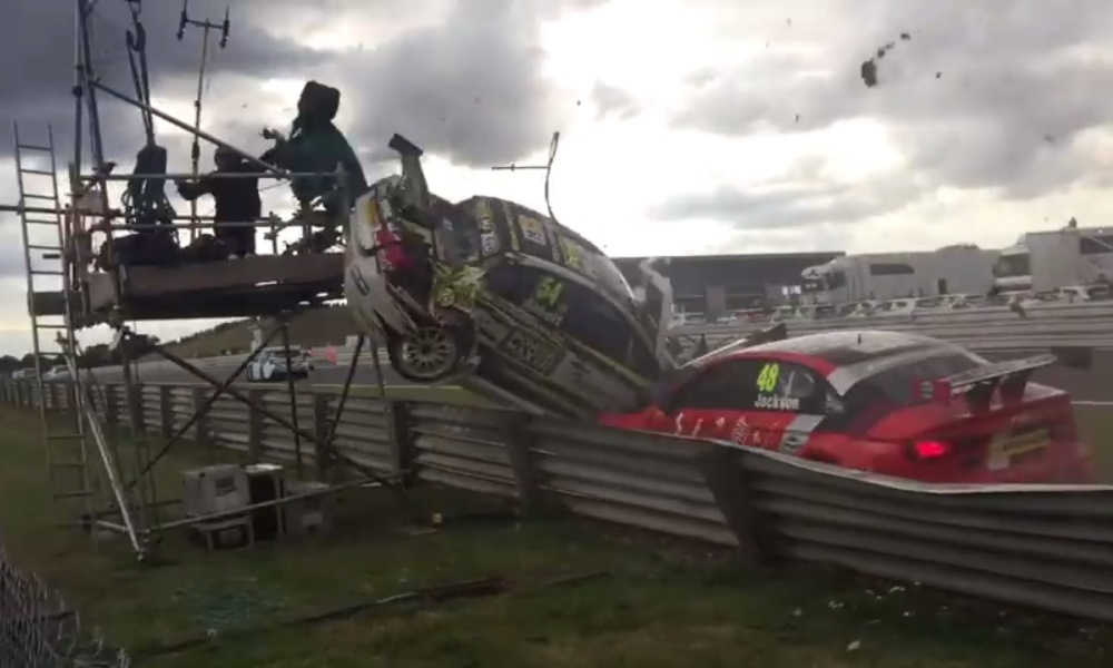 Watch this BTCC Chevy take out the cameraman.