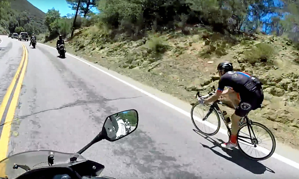 Cyclist overtakes bikers
