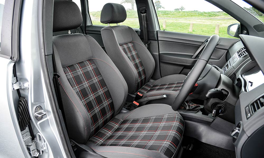 Tartan-trimmed front seats are a highlight.