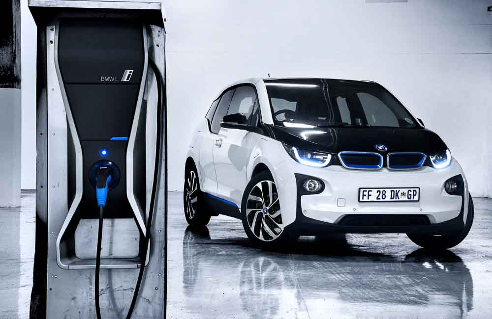 The BMW i3 REx in our garage next to its charging station.