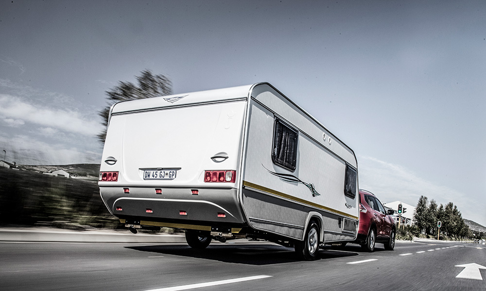 The law says you are not allowed to tow a medium to large caravan on a code B licence.