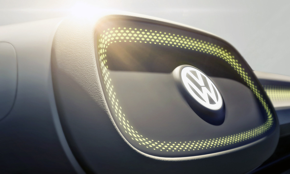 VW says a light press on this logo will see the steering wheel retract.