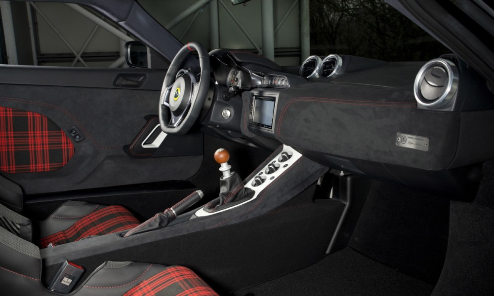 The interior features tartan upholstery and an Alcantara-covered dash.