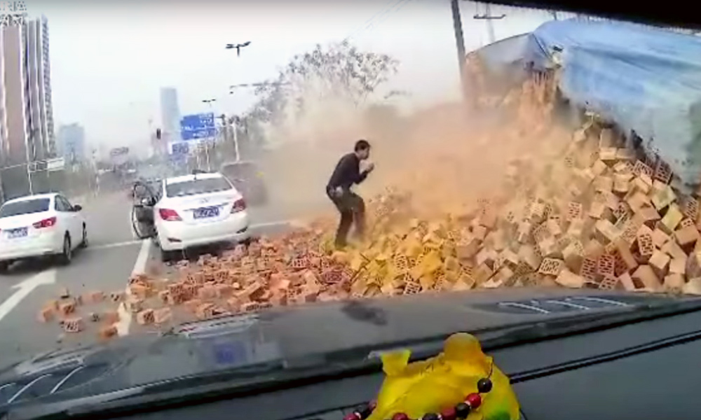 Car cuts in front of truck, causing crash.