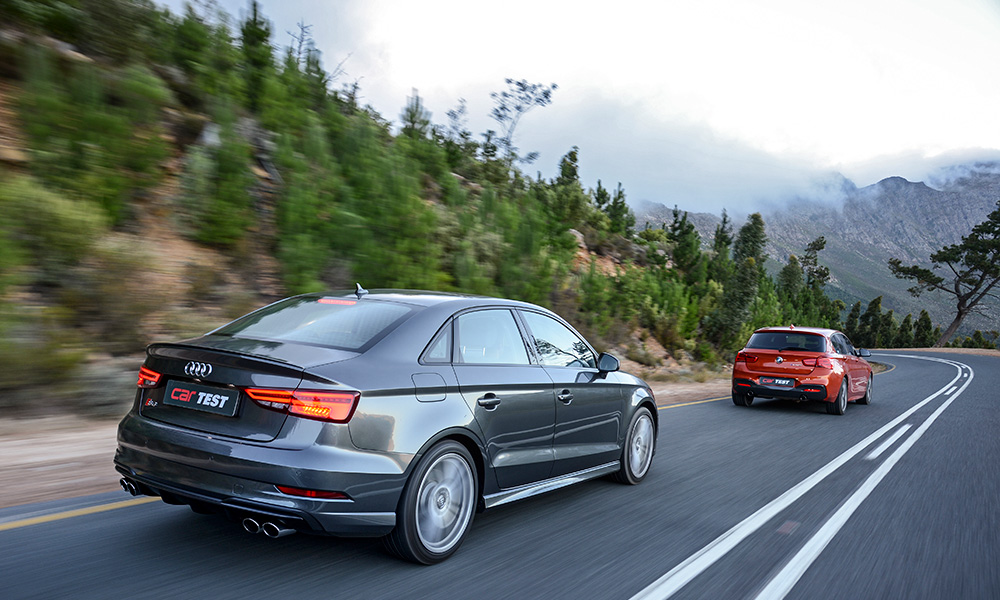 The fruity exhaust note of BMW even penetrates the cabin of the trailing Audi.