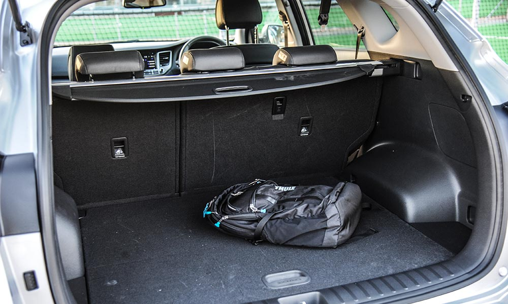 Boot floor in the Tucson hides full-size spare.