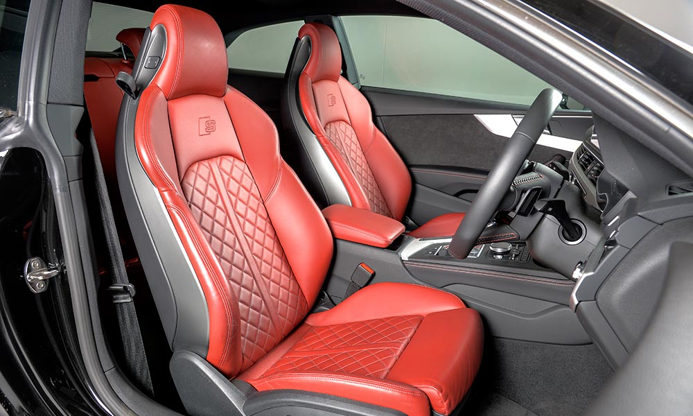 The deep-red leather seats of the S5 coupé.