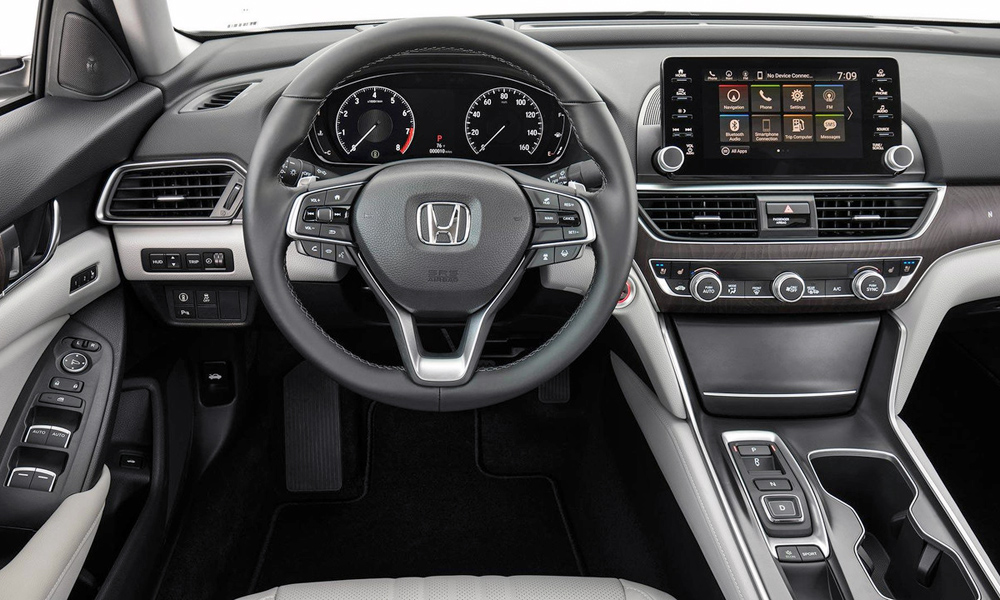The touchscreen is supplemented by physical volume and tuning knobs.