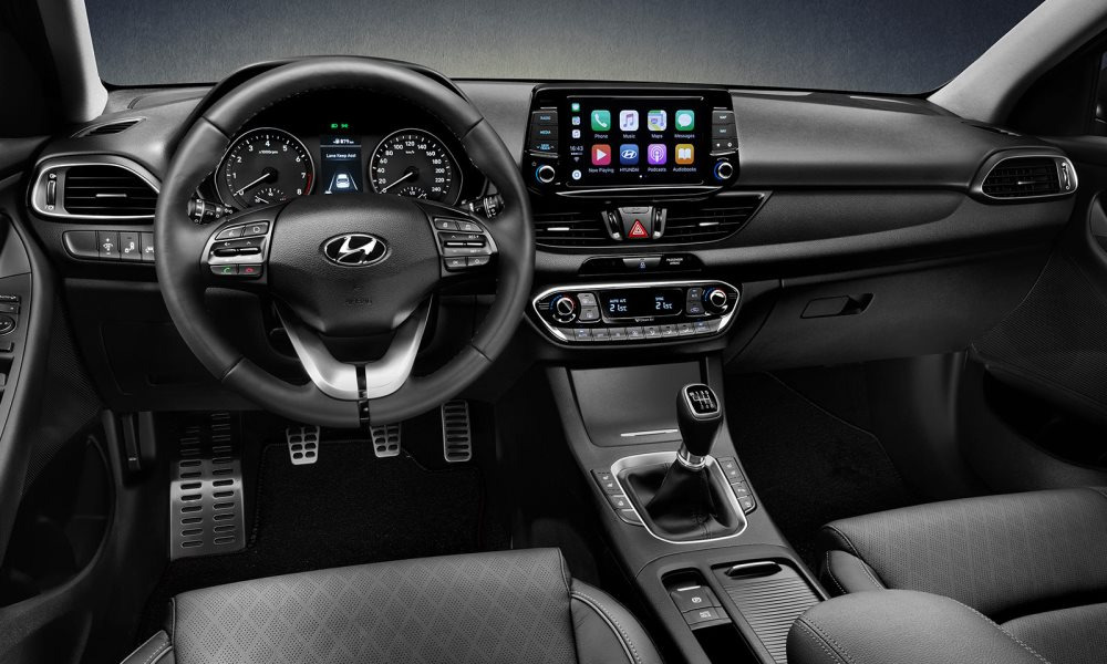 The interior shares much with the hatchback.