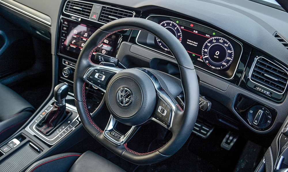 Red stitching in the GTI is a signature element.