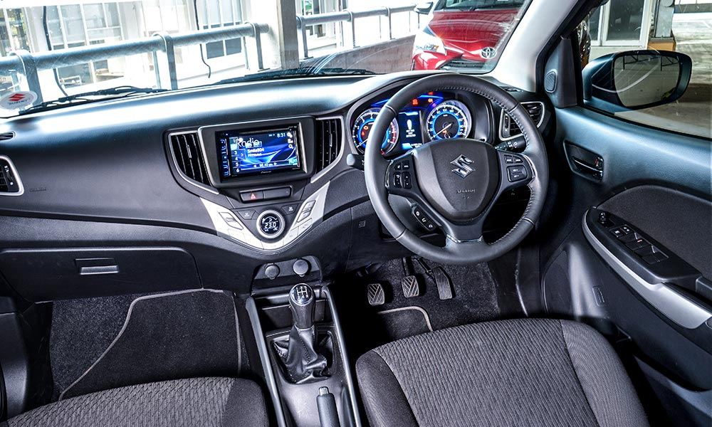 GLX specification in the Suzuki includes climate control, keyless entry and start, and cruise control.