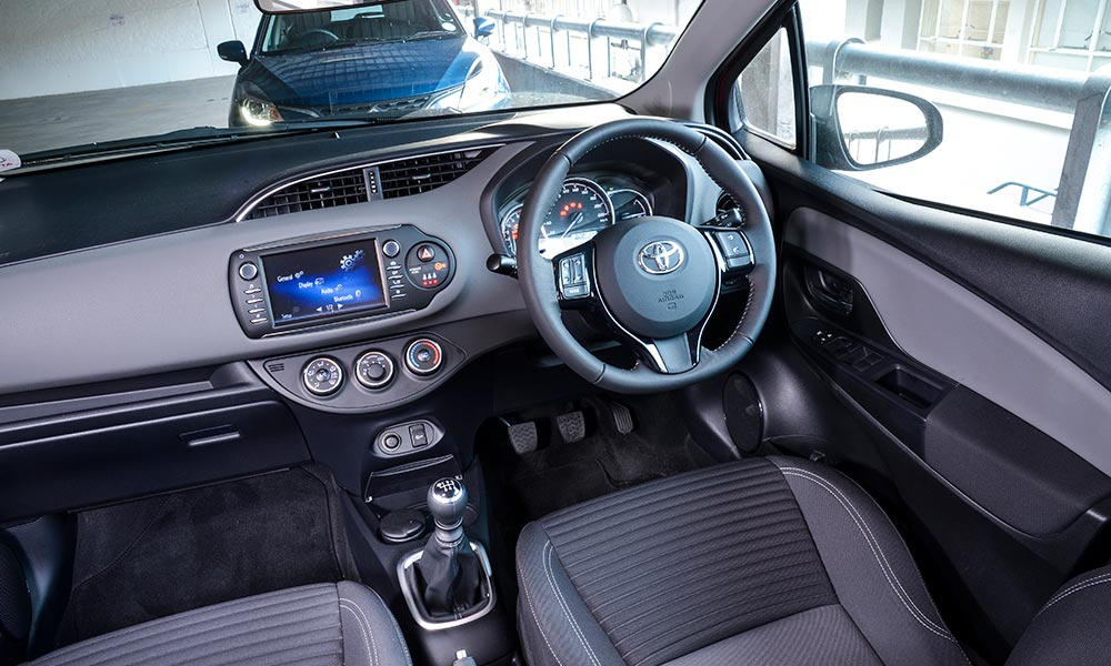 Neatly fitted infotainment system in the Toyota is complemented by steering wheel controls.