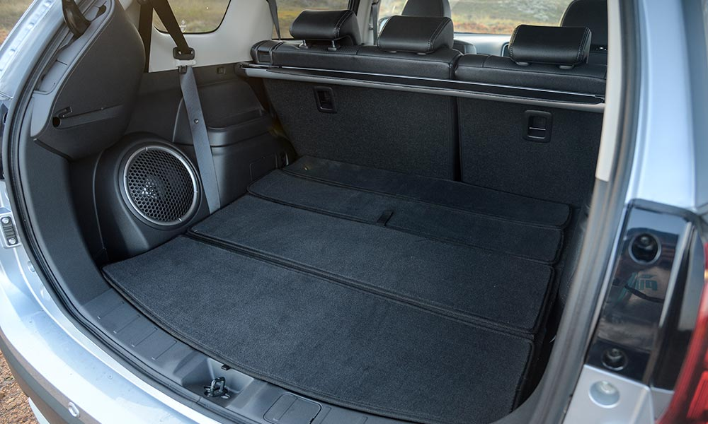 Spacious boot houses a massive subwoofer.