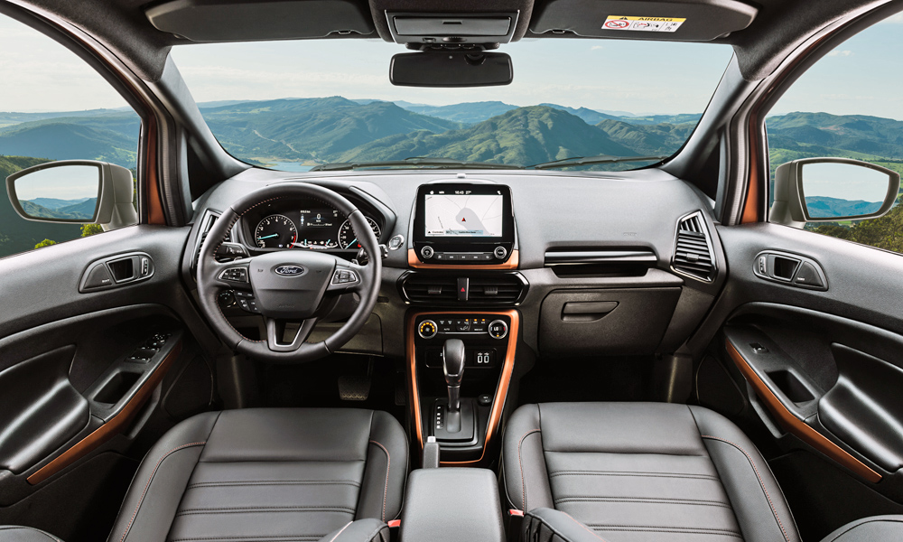 The cabin features leather seats and a smattering of orange trim.