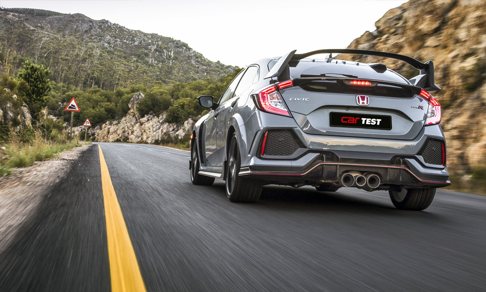 Rear wing and triple exhaust outlets dominate the Type R's rump.
