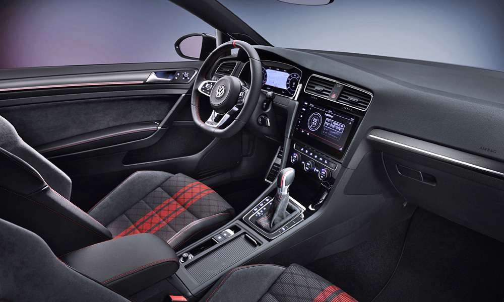 The seats gain model-specific microfibre and fabric covers.
