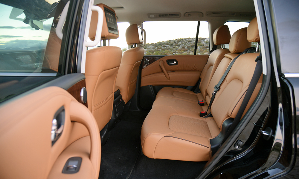 Dual DVD screens and dedicated air vents aid rear-passenger comfort.