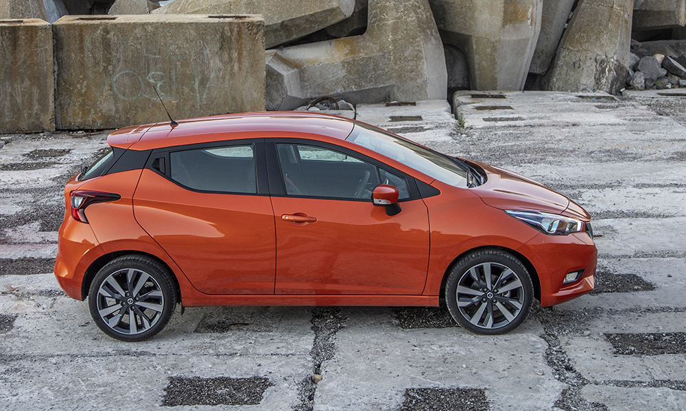 The profile shows off the Micra's squat design and undulating shoulder line that originates in the grille and flows into the protruding rear lamps.