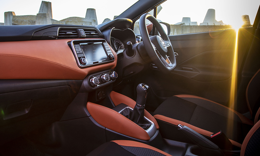 Pictured here is the new Micra's interior with Energy Orange contrast trim accents that are part of the Acenta Plus trim line.