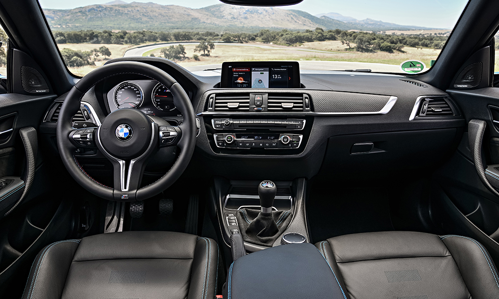 Inside the M2 Competition, there are revised instrumentation with black panel tech, carbon-like trim and M seatbelts.