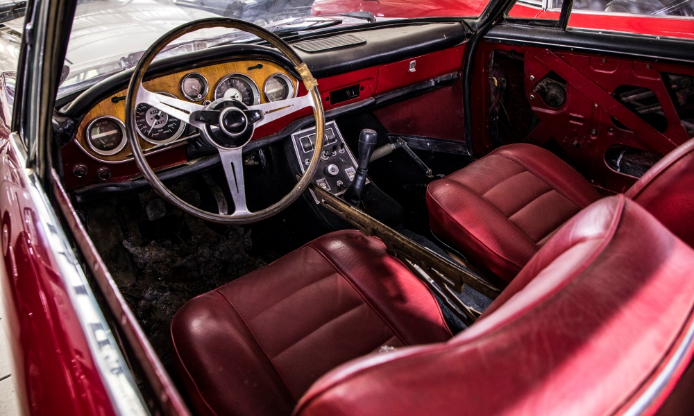 The oxblood interior of a 1963 Fiat 2300S Coupé.