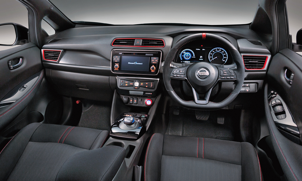 The cabin features faux-carbon trim and yet more red accenting.