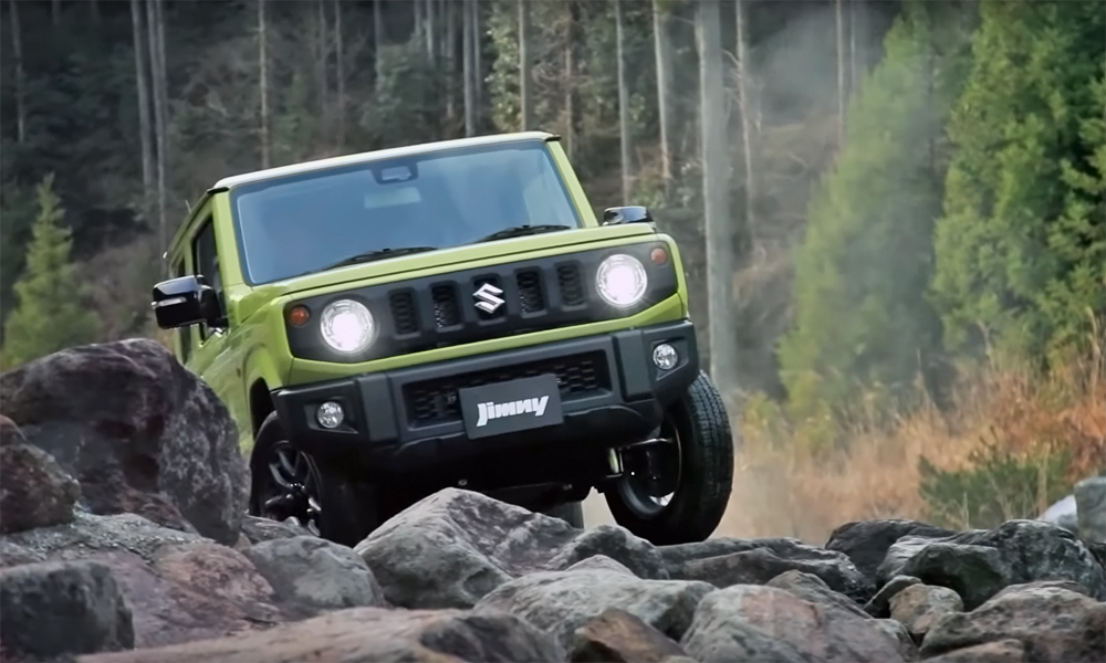 watch the new suzuki jimny tackle some off road obstacles. Black Bedroom Furniture Sets. Home Design Ideas