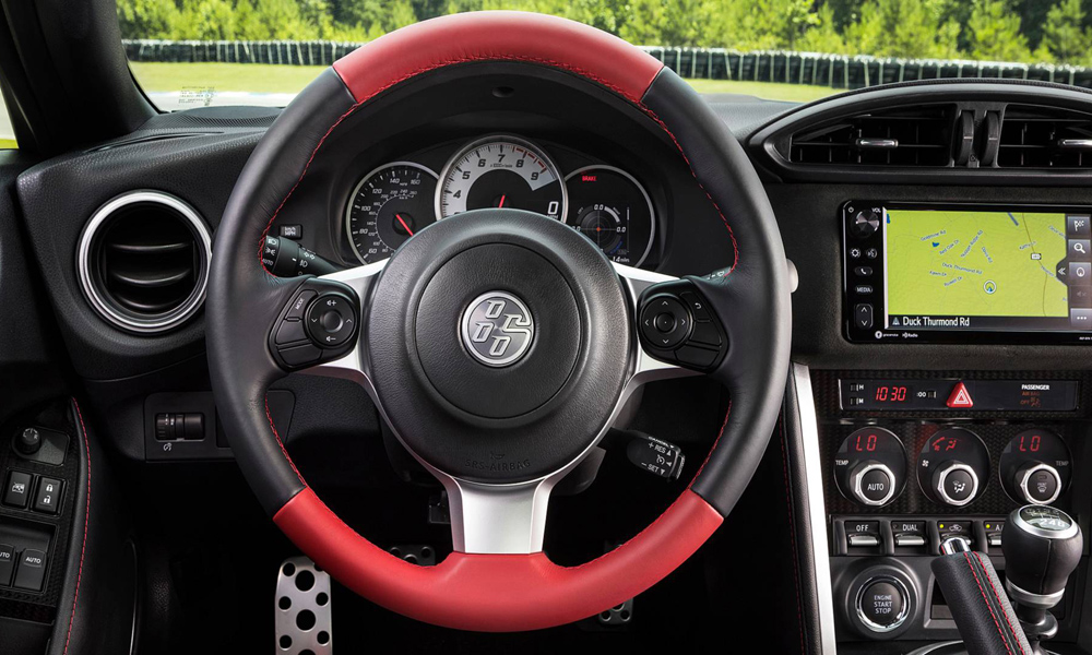 The steering wheel gains bold red accents.