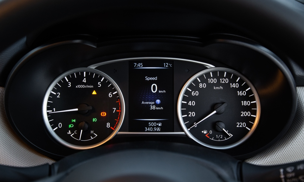 Analogue dials split by a five-inch colour screen.