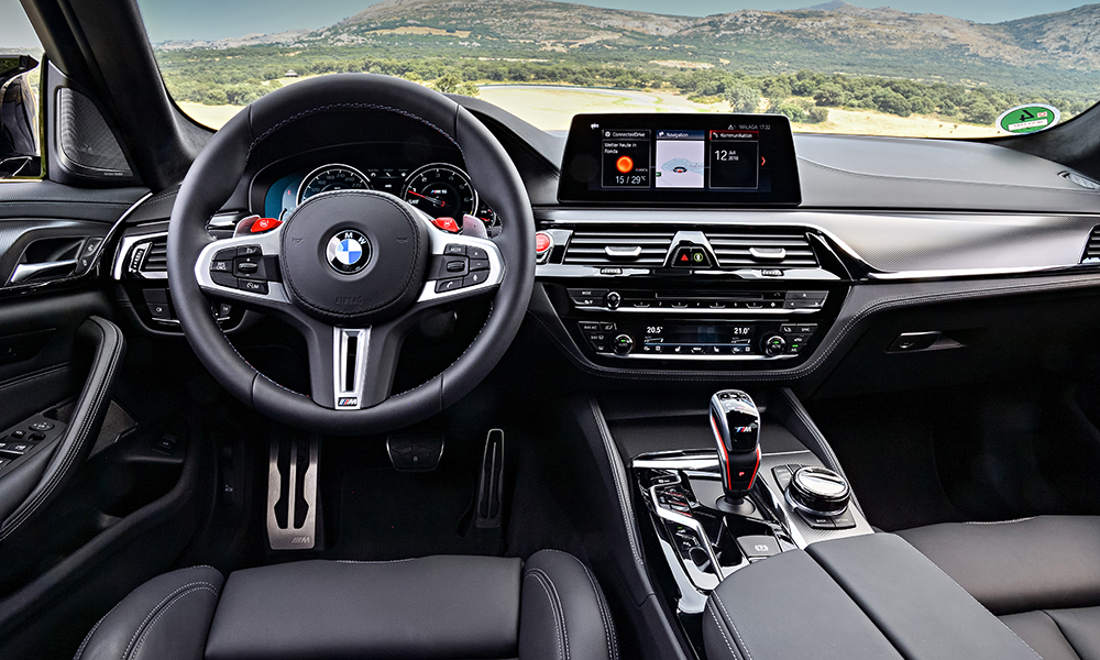 Changes to the interior of the BMW M5 Competition are subtle, encompassing striping on the seatbelts, piping around the floor mats and M Competition graphics.
