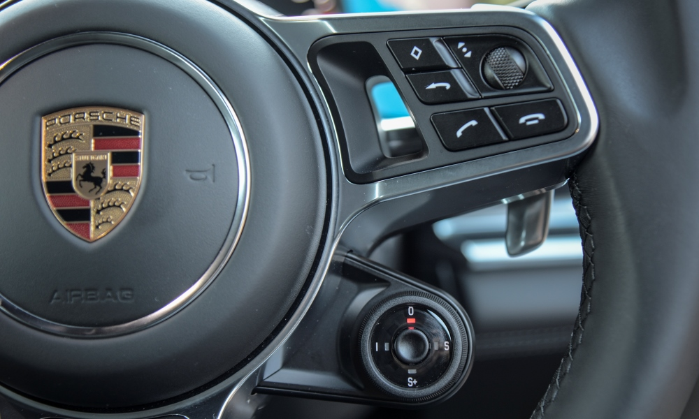 Drive-mode controller sited on the multifunction steering wheel.
