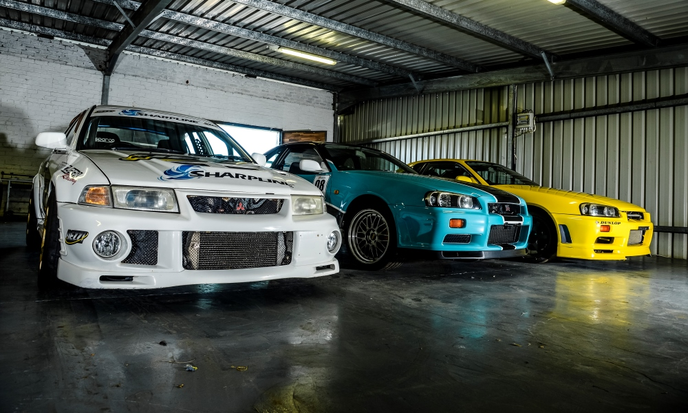 The Mitsubishi Evo V and two Nissan R34 Skylines.