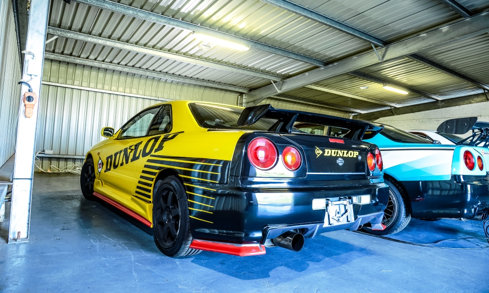 Rears of the R34 Skylines. GT on the left and GT-R on the right.