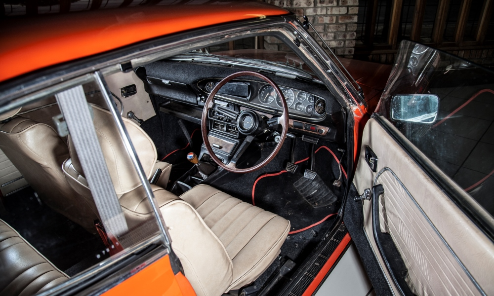 The cabin of a 1973 Datsun 1600 SSS.
